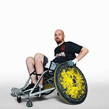 Portrait of man on wheelchair against white background