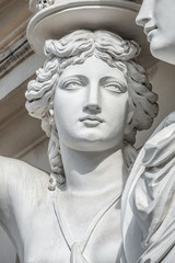 Tuinposter Historisch mon. Portrait of balcony support statue of young and naked sensual Roman renaissance era women in Vienna, Austria, details, closeup