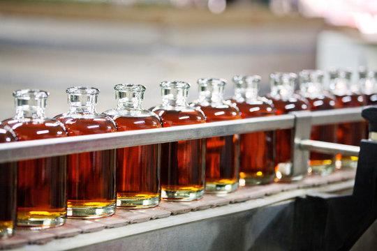 Whiskey bottles in cider at distillery