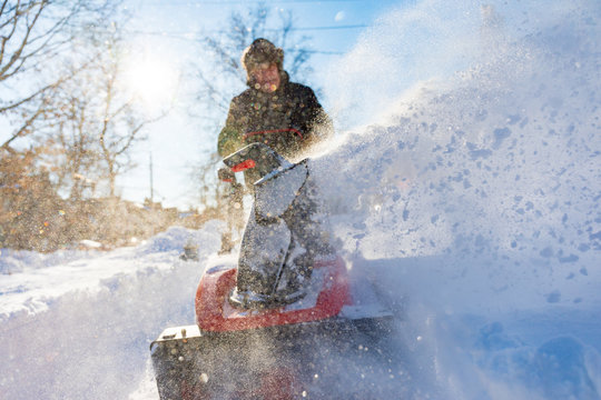 clearing snow with snowblower