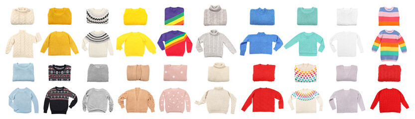 Fototapete - Set of cozy warm sweaters on white background