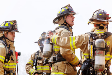 Firefighters standing against sky