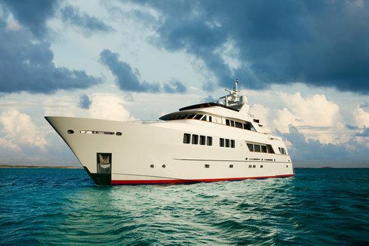 Yacht in sea against sky