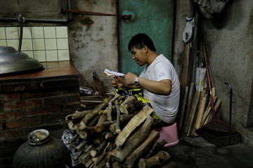 "The Wider Image: Taiwan's ""notebook boy"" commits his memories in writing"