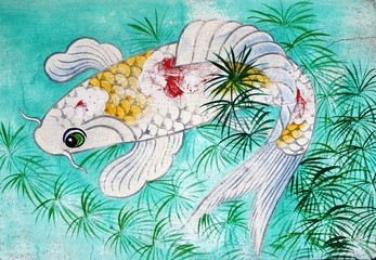 Fish swimming through weed in turquoise water illustration on an old Chinese Buddhist temple wall