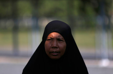 A Cambodian Muslim woman walks at the the Extraordinary Chambers in the Courts of Cambodia, as she waits for a verdict on the former Khmer Rouge Khieu Samphan and Nuon Chea, on the outskirts of Phnom Penh