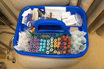 Phlebotomist blood drawing supply basket containing tubes and syringes. Minneapolis Minnesota MN USA