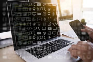 man work Coding software developer programmer is coding on a desktop computer