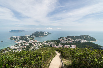 View over the Stanley town from the Wilson hiking trail in the hills in the south of Hong Kong island in China. Fotomurales