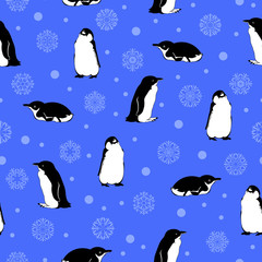 penguins and snowflakes. blue winter background. vector seamless pattern. textile paint. repetitive background. fabric swatch. wrapping paper.