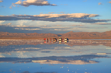 People Enjoy the Activities on the Mirror Effect of Salar de Uyuni Salt Flats at the End of Rainy Season, Bolivia, South America, 24th April 2018