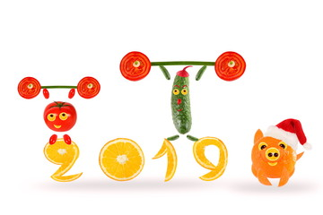 Creative food concept. Little funny vegetables with 2019. Happy New Year.