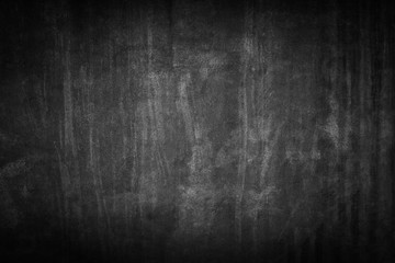 black background. Grunge texture. Dark wallpaper. Blackboard. Chalkboard