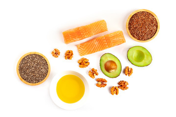 An overhead photo of the ingredients of a healthy omega 3 diet. Salmon, avocado, nuts, chia and flax seeds, shot from the top on a white background with a place for text