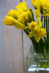 Printed roller blinds Narcissus One bouquet of yellow narcissus in the glass on the wooden background