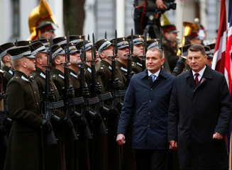 Latvia's President Raimonds Vejonis and Iceland's President Gudni Thorlacius Johannesson inspect honor guards during the welcome ceremony in Riga