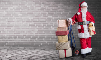 Santa Claus with presents on delivery trolley