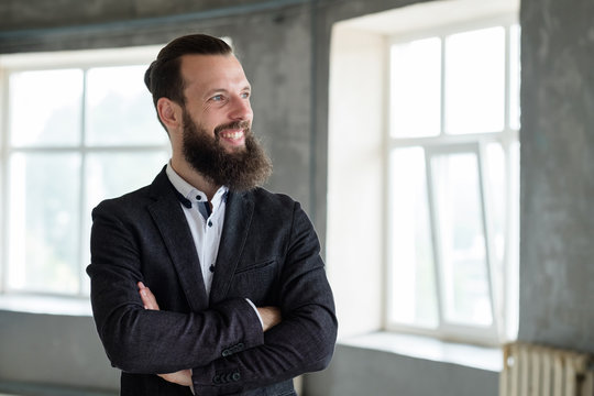 smiling business man with arms crossed. office dress code and stylish corporate look.