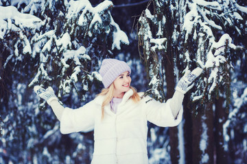 beautiful woman walking in a park and smiling fresh winter air and feeling wonderful