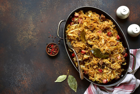 Bigos - cabbage stewed with meat, dried mushrooms and sausage.Traditional dish of polish cuisine.Top view with copy space.
