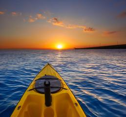 Fototapete - Kayak sailing in ocean sea at sunset