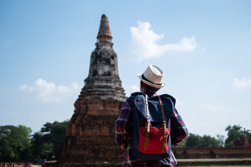 Senior man Asian with backpack are walking at Wat Chaiwatthanaram. Ancient and historical attractions and one of the most important archaeology of Ayutthaya province thailand. Travel, Tourist Concept