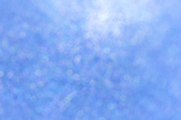 Blurred blue sparkles, soft and abstract full frame background.