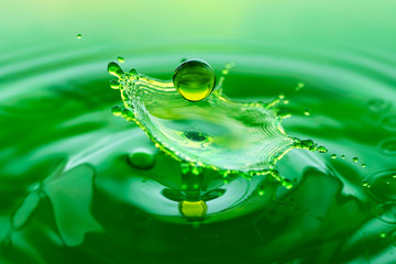 Green splash - falling drop of water