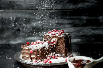 sweet moments - brownies poured hot, liquid chocolate, sprinkled with red pomegranate seeds and powdered sugar