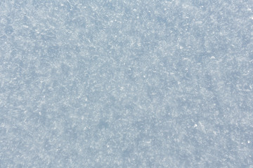 Winter snow surface with crystalline snowflakes
