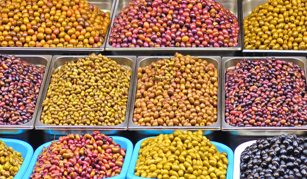 Assortment of all kind of olives on the stand in street market in Athens Greece
