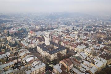 Aerial: City Hall of Lviv, Ukraine, misty weather