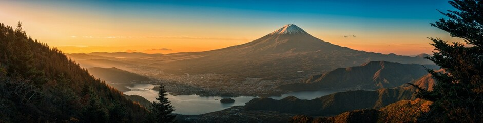 Mt. Fuji over Lake Kawaguchiko with autumn foliage at sunrise in Fujikawaguchiko, Japan.