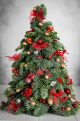 Christmas tree on a grey background. Image for cards, invitation, prints, posters.