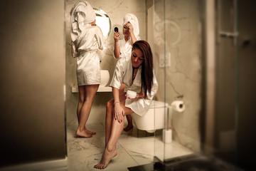 three girls in bathroom