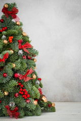 Christmas tree on a grey background with copy space. Image for cards, invitation, prints, posters.