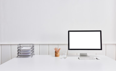 working table close up desktop screen folder and pencil white background.