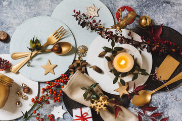 Holiday table setting, funny Christmas table with ornaments and natural berries