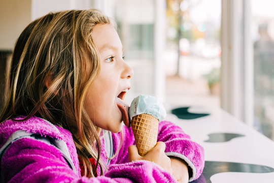 Smiling Girl With Ice Cream Cone