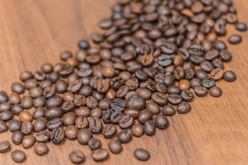 Coffee beans on a wooden background, free space