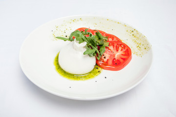 Buratta dish on a white background