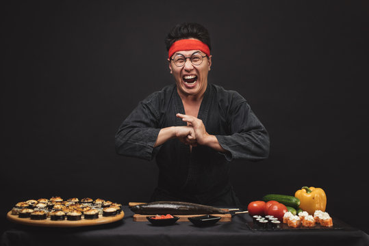 kung fu training while cooking. crazy mad man with funny grimace. close up photo.karate position. martial art concept. welcome