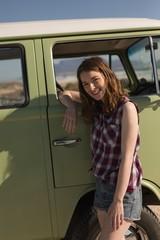 Woman leaning on van
