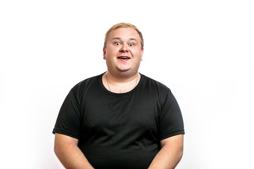 Funny picture of cheerful obese man on white background, looking at camera with happy expression. People, unhealthy lifestyle, diet and obesity concept.