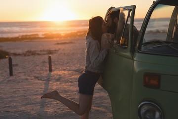 Couple kissing through van window
