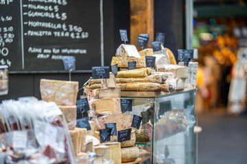 LONDON, UK - NOVEMBER 13, 2018 - Cheese and other quality Italian products such as Salami at London's famous markets located near the Borough Market