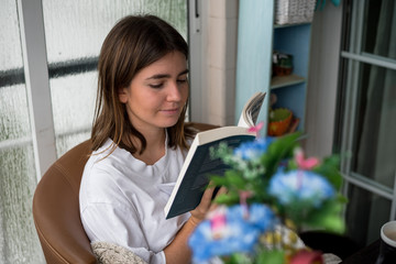 young woman reading a morning book