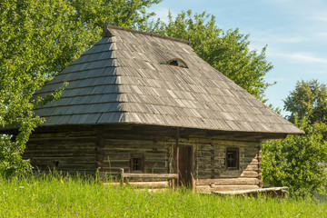View of an old typical wooden house in Romania.