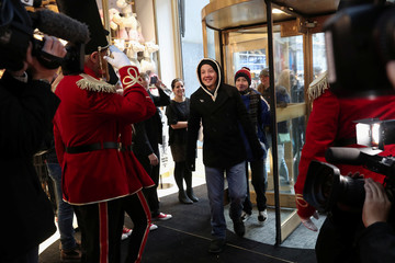 People enter the new flagship FAO Schwarz store in Rockefeller Plaza in New York