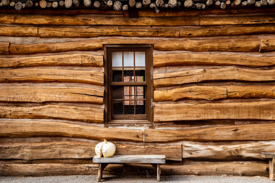 Log cabin outside wall with bench
